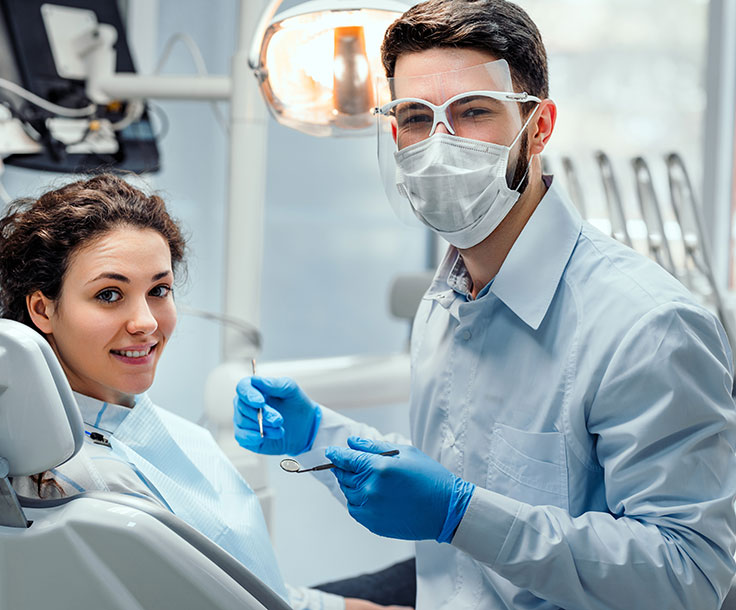 patient and hygienist wearing a mask
